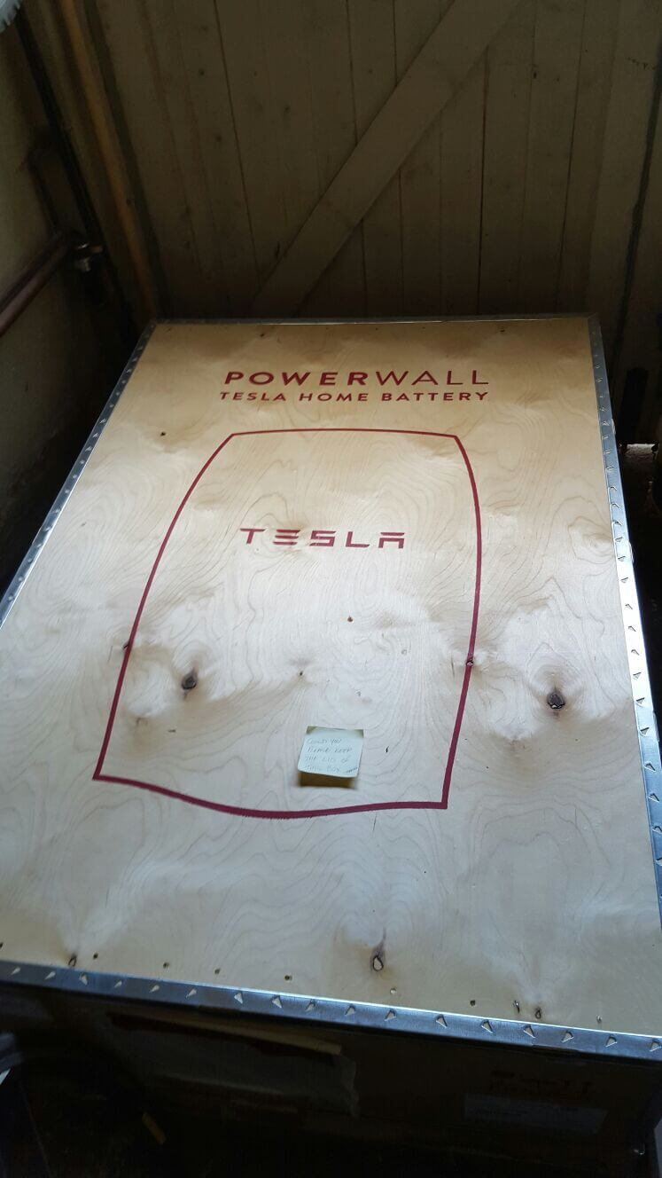 One newly delivered and boxed Tesla Power Wall