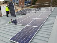 metal, trapezoidal, flush, pitched roof, solar install, solar panels